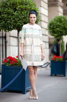 Jessica Stam looks elegant and prim in her pastel-hued shift dress and jacket.