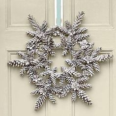 White snowflake pine cone wreath