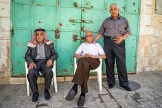 Palestinian men chat under the sun in the West Bank city of Hebron. …