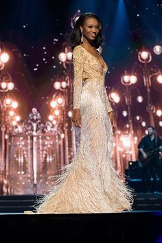 Beaded evening gowns like this one worn in #missusa can be made by our Texas based design firm. The long sleeve design wowed on stage.  The long fringe on the skirt and the heavily beaded pattern on the bodice gave major bling. You can find out how much custom #pageantgowns like this would cost with our company by visiting us at www.dariuscordell.com