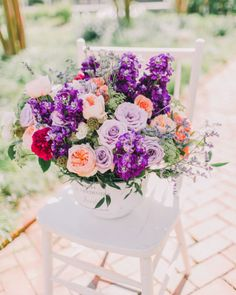 Lavender and bright purple flowers with popss of peach and red: http://www.stylemepretty.com/2014/07/01/romantic-lavender-wedding-inspiration/ | Photography: Rachel May - http://rachel-may.com/