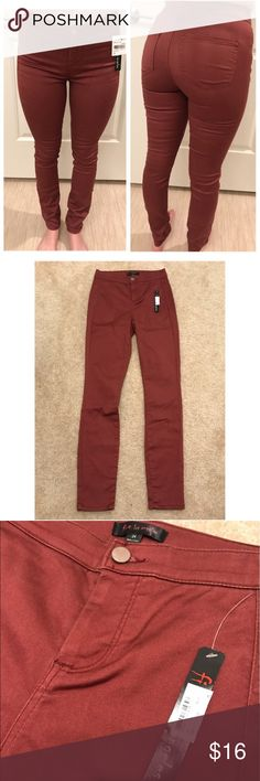 Fire Los Angeles Rust Red Maroon Burgundy Jeans Stretchy like Jeggings, I'm size 25 and fit them fine. They were nice and tight but stretchy enough to be comfortable so I'd recommend for a 0-1 or 24-25. Color is a burgundy but a little more orangey toned like a rust red. Very flattering on the butt. 2 pairs available, price is for one pair of jeans. Fire Los Angeles Jeans Skinny