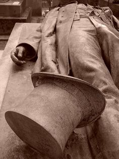 Paris, Victor Noir.  Died in Paris 1870,a french journalist ,his tomb became a fertility symbol.the grave has a very noticeable bulge in Noir's trousers.Myth says that placing a flower in the up turned hat ,after kissing the statues lips or rubbing its genital area,will enhance fertility,bring a blissful sex life , or a husband within the year .