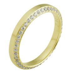 Obrączka ślubna z żółetgo złota z brylantami o łącznej masie 0,44 ct. Próba 0,585