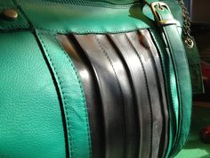 big shoulderbag, made of green leather and used bicycle innertubes