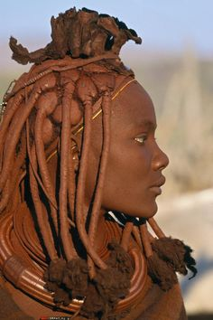EXILE looks - adding glitter or gold-leaf to highlight matted tresses (Tribal people - Himba, of Namibia)