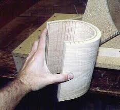 plywood speakers - see just how easy plywood bends when you cut 1/8 inch kerfs in the back of 3/4 inch oak cabinet plywood.