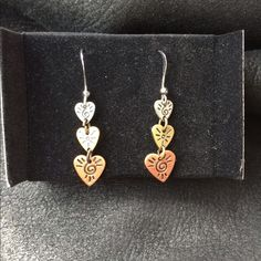 Triple Heart Delicate Drop Tritone Earrings Beautiful tritone hearts drop earrings. Vintage circa 1999/2000 from Avon. Still in box. Dangling with wire backs. I believe parts are sterling silver. Never worn. Avon Jewelry Earrings