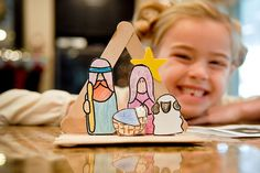 Paper Nativity scene + popcicle stick stable. Such a cute Christmas art project for preschoolers.
