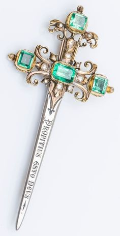 An antique gold, silver, emerald and diamond brooch, French, 19th century. Designed as a sword set with 4 square emeralds and rose-cut diamonds. The blade is engraved 'Propitius esto Deus', Gospel according to St Luke, Chap. 18, V. 13. The pin belonged to a papal chamberlain, William Huffer. #antique #brooch
