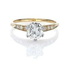 Replica Edwardian Engagement ring. A Beautiful Old European Cut Diamond weighing .83 cts and assessed by the UGL appraisal service as K color and SI2 Clarity is set in a beautiful six prong platinum crown. Six small diamonds are bead set into the engraved 18k Yellow Gold Shoulders. Lovely