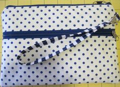 No pattern, just straightforward cutting! Using a little more than two fat quarters and two twelve-inch zippers, Bethany sewed this sweet wristlet clutch bag up for