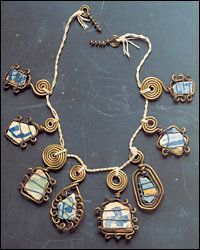 Calder used brass wire, ceramic and string to commemorate his mother's birthday. Necklace, 1930.