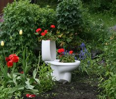Garden toilet.. everything has a repurpose...just redid the bathroom and this is what I am saving the old toilet for!!!