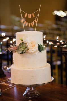 wedding cake and banner topper