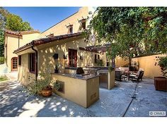 315 West Santa Clara Avenue     Restoration won Best Historical Remodel in 2005. I love that even though its all new, it fits the architectural style of the house. outdoor kitchen with stainless steel BBQ. Outdoor living room with wood-burning fireplace.
