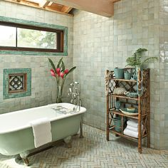 Get Cohesive with Color: This master bathroom's shimmering Moroccan tiles are a softer take on the vibrant greenery outside and create a relaxing tone for a long soak. The light green tub—instead of a traditional white or cream—unifies the space. | CoastalLiving.com