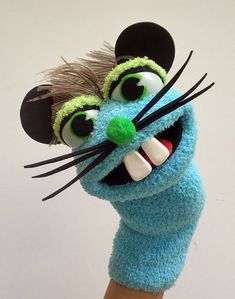 A nice and funny mouse Sock hand Puppet - Hand made with love. - Made using the highest quality materials. - Exceptional quality and value. - Tested to be safe and durable. - Using one hand to open and close his mouth. - For fun at home or educational purposes at classroom , story time.