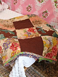Quilt from The Country Living Fair, love the large floral prints with the brown solid fabric