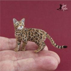 Dollhouse Miniature Bengal Cat sculpture of polymer clay, wire, suri alpaca fiber & heat-set inks.