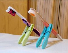 Use clothespins to keep your kid's toothbrush from touching dirty counters while on the road. | 21 Indispensable Tips And Tricks For Traveling With Kids