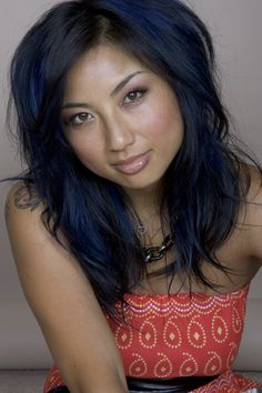 I love Jeanie Mai's hair. blue-Black with chunky bright blue peekaboo highlights and long beautiful layers... when mine finally gets longer this will be my next hair adventure