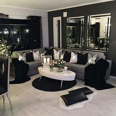 Beautiful living room. I like the way they hung 2 mirrors instead of one big one.