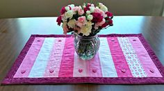 Get instructions for this cute and simple machine quilted, Valentines Day table runner.