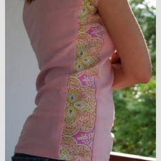 Here's another example of upcycling a t shirt that's too small by sewing a contrasting panel into the side seam.