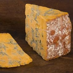 Shropshire Blue.  A cow's milk blue cheese from the United Kingdom and is technically a cross between Stilton and Cheshire. Pairs with riesling or pinot noir.