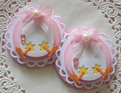 Sara's Scrappin  this blog has cute ideas for embellishments
