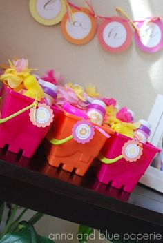 using buckets for luau party favors, make it an adult party favor by just switching to mini liquor bottles, a shot glass, and sunglasses