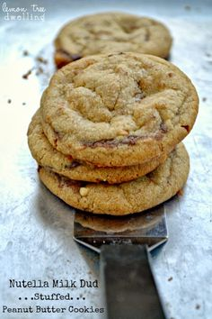 Nutella Milk Dud Stuffed Peanut Butter Cookies from Lemon Tree Dwelling  #nutella #milkduds #cookies