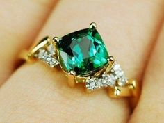Green tourmaline ring in a square cut, but uniquely set to look like a true diamond-shape with small accents hugging the sides