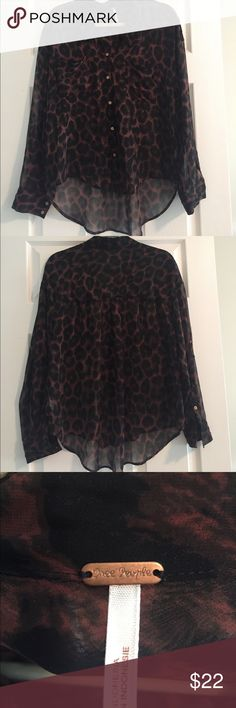 Free People Sheer Animal Print Blouse S Sheer animal print blouse from Free People has v-neck with collar and two breast pockets. Hi-lo hem on this tunic length blouse. Sleeves can be rolled and buttoned in place. Size S. Free People Tops Blouses