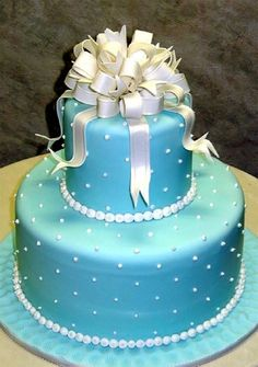 An enduring beauty -- a two-tiered bow cake in Tiffany blue. tlcasia.com #CakeBoss