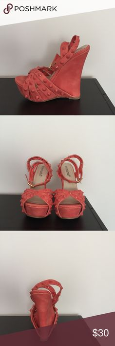 Bright orange wedges with spikes design Orange wedges with a 5inch heel and 2 inch platform. Wedges have a beautiful design all round. Perfect with a summer dress, jeans or bikini . Brand new with no tags, never been worn Shoe Dazzle Shoes Wedges