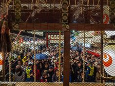 Asakusa Tori no Ichi 5/8 The ceremony is over but there is a huge crowd waiting to pray at the Otori Jinja even though it is now after 00:00 -this is how the crowd looks from inside the shrine (the chicken wire is to stop the coins thrown to the saisenbako collection box reach the actual shrine). #Asakusa, #Tori, #Ichi, #Otori, #Jinja, #saisenbako, November 9, 2014 © Grigoris A. Miliaresis