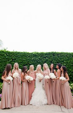 Long, silky pink bridesmaid dresses.  Photography By / http://capturedbyjen.com @Style Me Pretty