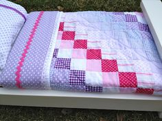 doll quilt: purple and pink