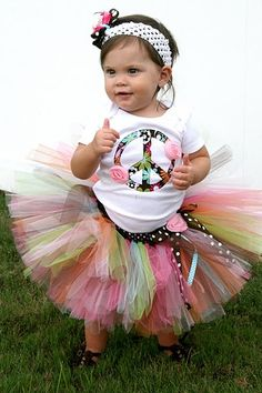 PEACE!  Hippy Chic tutu set.  Tutu done in brown, light pink, hot pink, orange, lime and teal and finished with a brown polka dotted bow and pink fabric rosette.  Top is appliqued with a peace sign in coordinating floral fabric and embellished perfectly with 2 little pink rosettes.