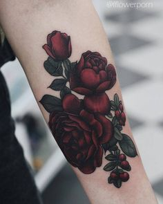 Illustrative red rose tattoo on the left inner forearm. Tattoo Artist: Olga…