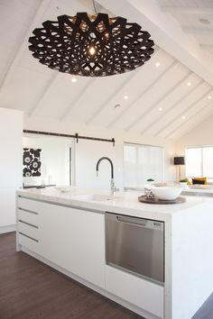 A showpiece light shade from David Trubridge features in our Beachlands Showhome.