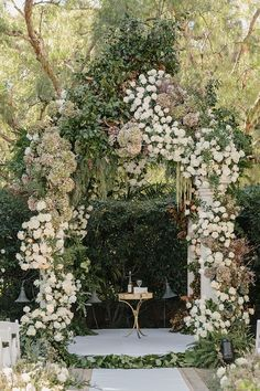 Abundant white floral wedding arbor. Beverly Hills Wedding.