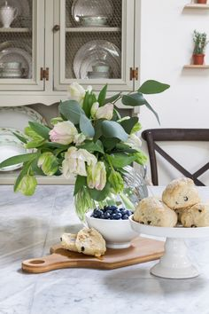 A Spring Kitchen Tour introducing the elements of the season all in Farmhouse/Cottage style. Flaky scones and parrot tulips freshen up the space.