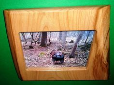 This rustic picture frame is handmade. We have our own sawmill and use the trees from our woodlot for our woodworking projects. To make our