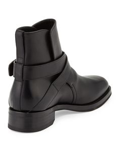 """Tom Ford """"Guilford"""" calf leather Chelsea boot. Crisscross straps with gold buckle across vamp. Round toe. Back pull-tab at heel. Leather lining and insole. Stacked heel. Made in Italy."""