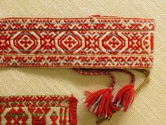 Traditional Sami belt, probably woven on a rigid heddle. Look at those colors and shapes!