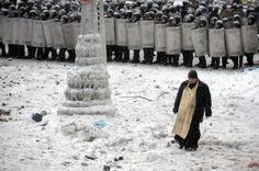 In Kiev, Priest Pray On The Frontline