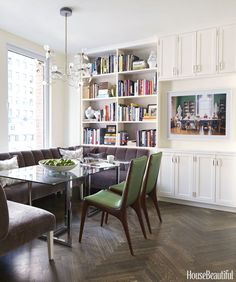 A glass-topped Silverado dining table by CB2offers lots of legroom above the wraparoundbanquette,upholstered with a durable, super-softMaharam mohair. Vladimir Kagan chairs are covered in Maharam's Sudden.Birdie chandelier by Ingo Maurer.   - HouseBeautiful.com